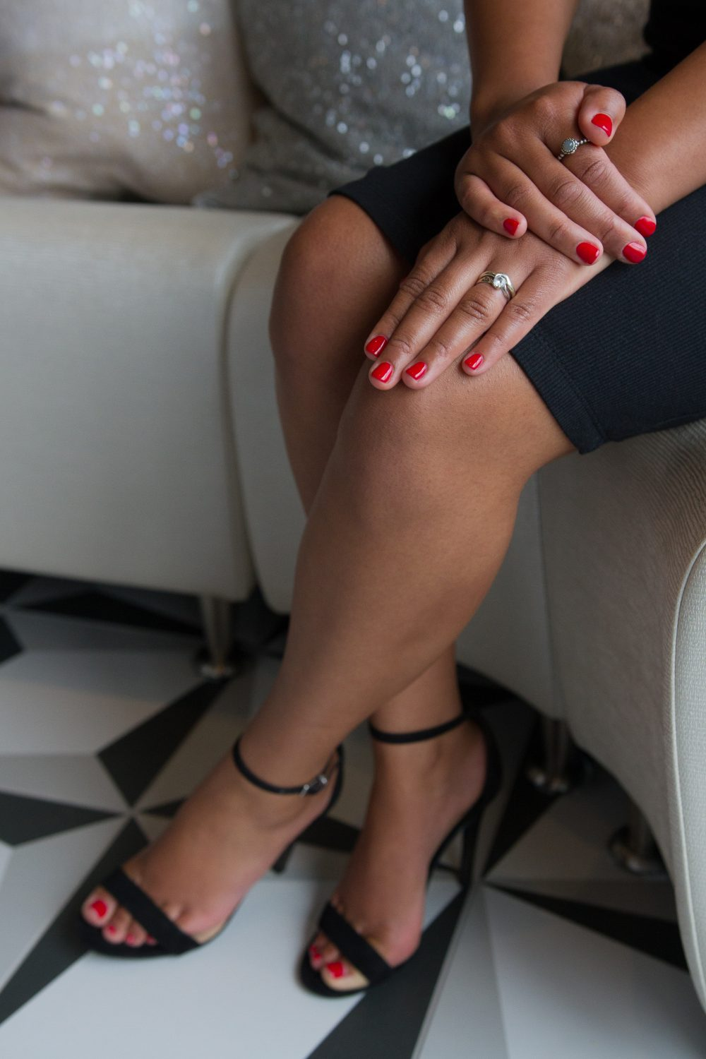a client with matching red gel manicure and pedicure