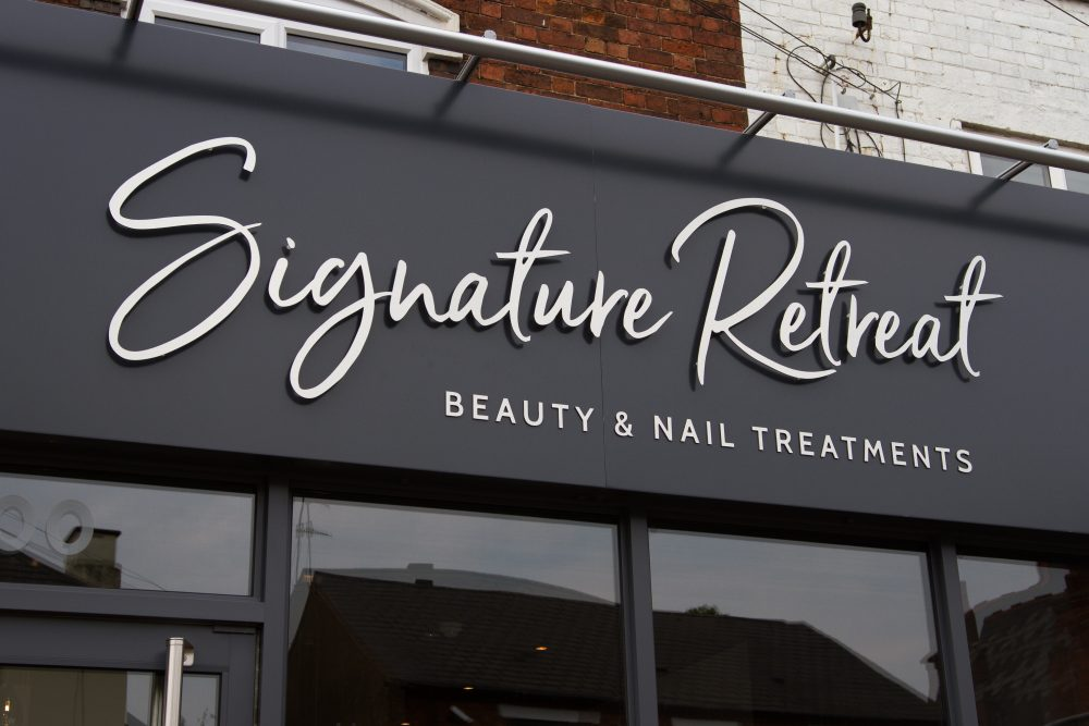 a photo of the salon's signage, signature retreat beauty and nail treatments